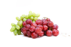 Close-up of a bunch of grapes. Green  and purple Royalty Free Stock Photos