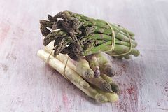 Close up of bunch of young green and white asparagus Royalty Free Stock Photo
