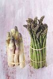 Close up of bunch of young green and white asparagus Royalty Free Stock Image