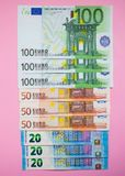 Close up bundle of money Euros banknotes on the color background. Bundle of money Euros banknotes on the color background stock photo
