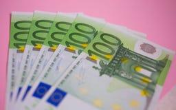 Close up bundle of money Euros banknotes on the color background. Bundle of money Euros banknotes on the color background royalty free stock photos