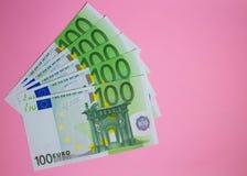 Close up bundle of money Euros banknotes on the color background. Bundle of money Euros banknotes on the color background royalty free stock images
