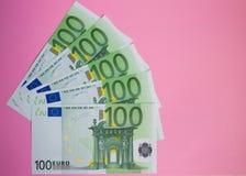 Close up bundle of money Euros banknotes on the color background. Bundle of money Euros banknotes on the color background stock image