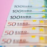 Close up bundle of money Euros banknotes on the color background, business, finance, saving, banking concept. Close up bundle of money Euros banknotes on the royalty free stock photo