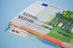 close up bundle of money Euros banknotes on the color background, business, finance, saving, banking concept royalty free stock images