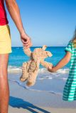 Close up bunny toy in the hands of daughter and dad on sea background Royalty Free Stock Photos