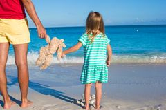 Close up bunny toy in hands of little girl and dad royalty free stock photo
