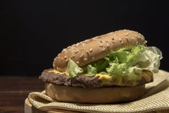 Close-up of Burger on black background. royalty free stock photo