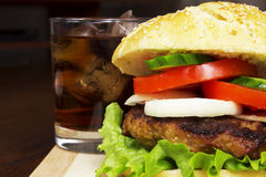 Close up Burger & Cola. Close up burger with cola drink in background Royalty Free Stock Image