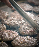 Close up of burgers on a barbeque Royalty Free Stock Image