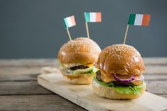 Close up of burgers with Irish flag. Served on cutting board stock photo