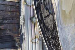 Close up Burned damaged ruins of destroyed supermarket arson investigation insurance royalty free stock image