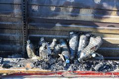 Close up Burned damaged ruins of destroyed supermarket metallic facade arson investigation insurance stock photography