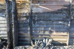 Close up Burned damaged ruins of destroyed supermarket metallic facade arson investigation insurance stock images