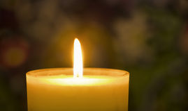 Close up burning candle. On colorful background Stock Photography