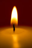 Close-up of a burning candle on a dark background Royalty Free Stock Image
