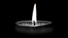 Close-Up Of Burning Candle In Darkroom Stock Images