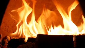 Close up for burning fire in old fashioned oven for baking food. Frame. Traditional oven, burning woods and flames in royalty free stock image