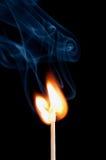 Close up of burning match. Burning match with smoke on black background Royalty Free Stock Photo