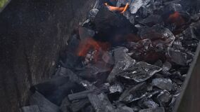 Close-up burnt of burning coals in barbecue grill slow motion top view footage