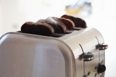 Close Up Of Burnt Toast In Toaster Stock Photography