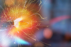 Close up of bursting sparkles. On dark background Stock Image