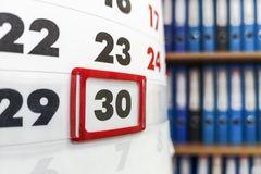 Close up of business calendar on background of office document folders. Business concept stock image