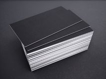 Close-up of business card on a black background. 3d rednering. Royalty Free Stock Image