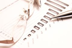 Close-up of business chart with glasses Royalty Free Stock Photo
