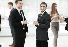 Close up.business colleagues discuss business problems standing in the office stock photography