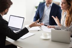 Close up of business colleagues negotiate on contract conditions. Close up of diverse business partners gesturing having dispute or disagreement on contract royalty free stock photo