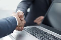 Close up.business colleagues shaking hands with each other stock photos