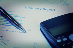 Close up business concept, Pen is on summary report and calculat Royalty Free Stock Photography