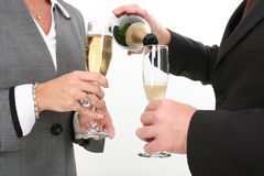 Close-up Business Couple Pouring Champagne Royalty Free Stock Images