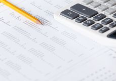 Close up of business document with pen and calculator Stock Photography