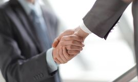 Close up.business handshake on blurred office background royalty free stock photography