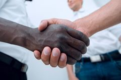 Close up.business handshake business partners. Concept of cooperation stock images