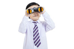 Close-up business kid holding binoculars - isolated Royalty Free Stock Photography