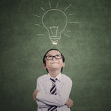 Close-up business kid on lamp drawing Stock Photo