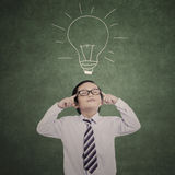 Close-up business kid thinking and drawn bulb Stock Image