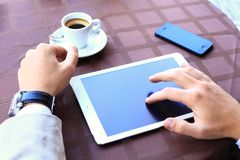 Close-up of business male hands touching digital tablet Stock Photos