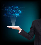 Close-up of business man brain. With tablet in hand Stock Images