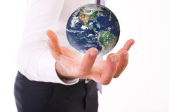 Business man carrying earth. Close up of a Business man carrying earth Stock Photos