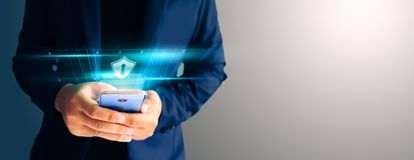 Close up business man formal blue suit Use hold smart phone in the dark. royalty free stock images