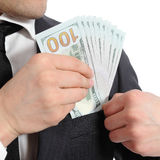 Close up of a business man hand keeping money in his pocket Royalty Free Stock Photos
