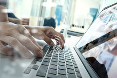 Close up of business man hand working on laptop computer Stock Photos