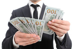 Close up of a business man hands counting banknotes Royalty Free Stock Image