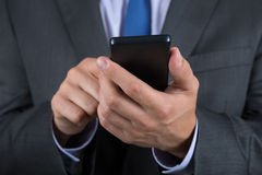 Close up of business man hands holding mobile phone Stock Photos
