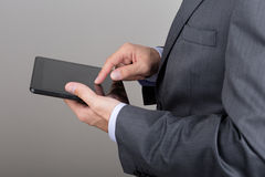 Close up of business man hands holding tablet pc. Close up of business man hands reading something on his tablet pc Stock Photo