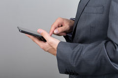 Close up of business man hands holding tablet pc. Close up of business man hands reading something on his tablet pc Royalty Free Stock Photo